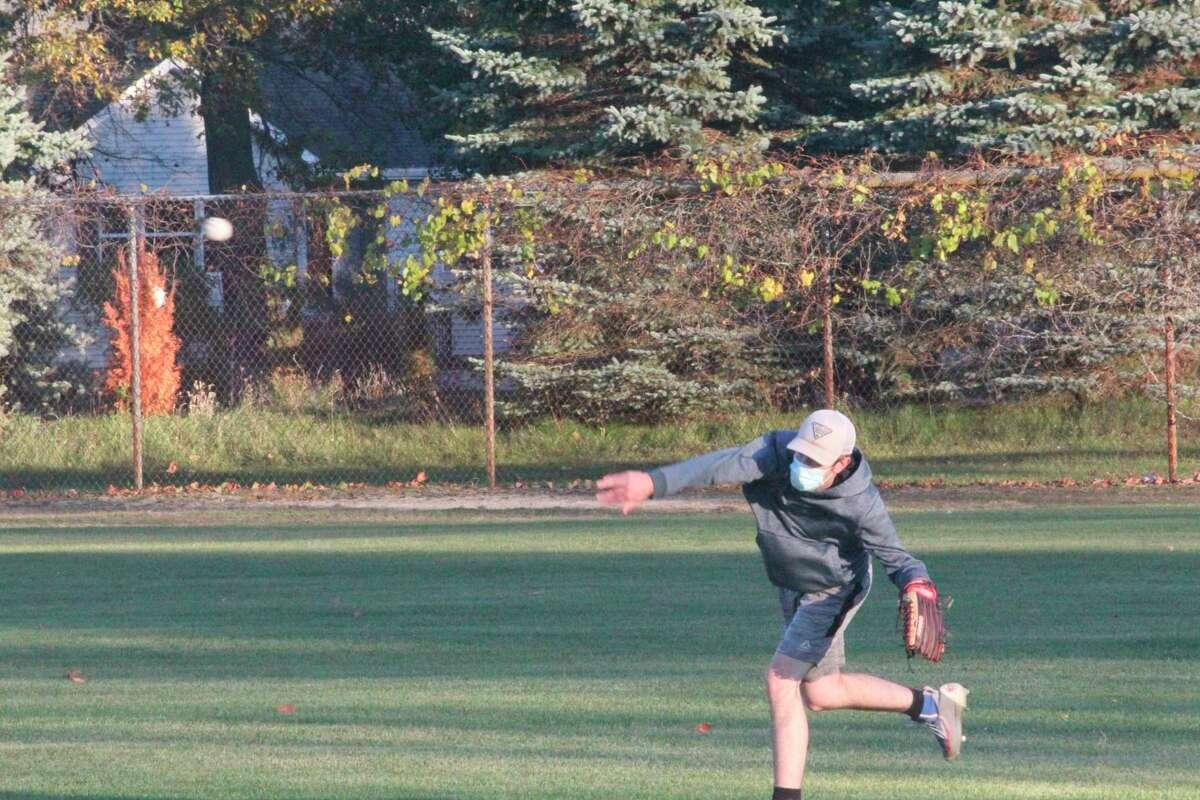 Big Rapids baseball player Nathan Bird makes the throw during a Cardinal practice on Thursday at Win Kellum Field. (Pioneer photo/John Raffel)