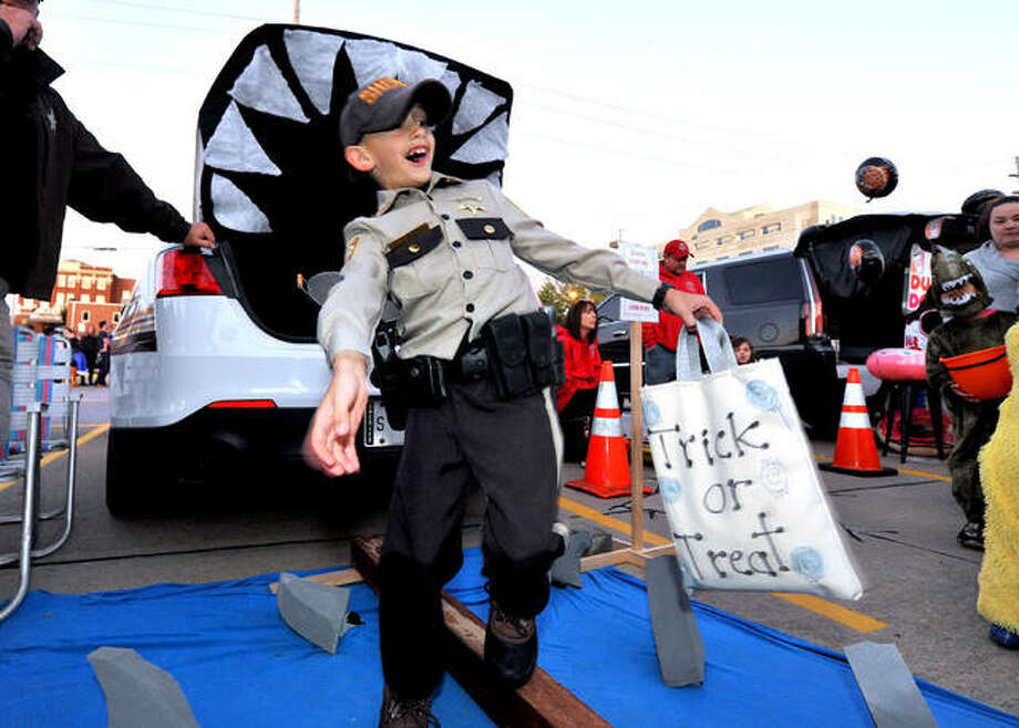 Elliot Rayburn, 8, of Mt. Olive attempts to keep his balance as he walks a plank over pretend shark-infested waters during the Madison County's Trunk or Treat in Edwardsville last year. Photo: Thomas Turney | Intelligencer File Photo