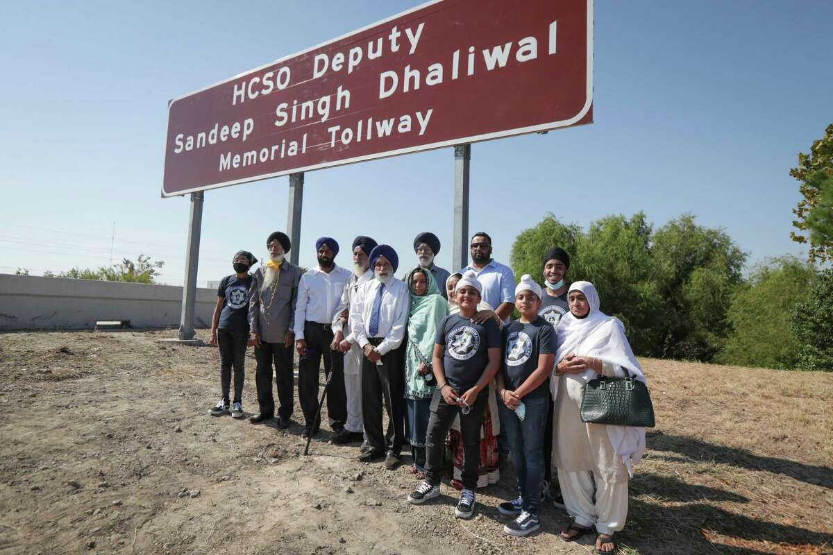The Dhaliwal family have their photo taken during the renaming of a portion of Beltway 8 (between 249 and 290) on the Harris County Toll Road Authority in northwest Harris County in honor of Sheriff Deputy Sandeep Dhaliwal ceremony Tuesday, Oct. 6, 2020, in Houston.