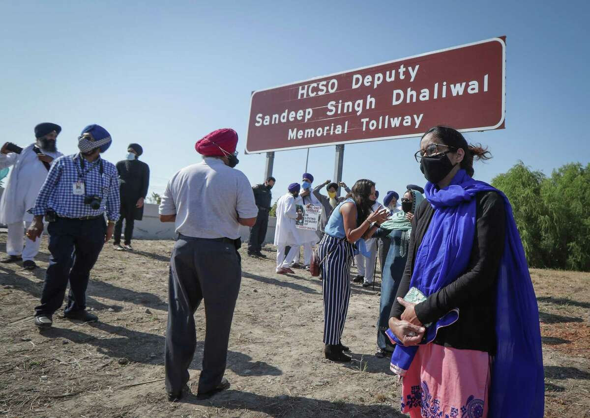 Sheriff Deputy Sandeep Dhaliwal's widow Harvinder Kaur pauses during the renaming of a portion of Beltway 8 (between 249 and 290) on the Harris County Toll Road Authority in northwest Harris County in honor of Dhaliwal Tuesday, Oct. 6, 2020, in Houston.