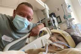 Kevin Swearingen and his daughter Charlee, 16, who remains on life support infected with COVID-19 at a Houston hospital.