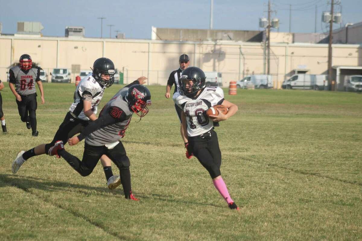 A Victory Lakes Intermediate quarterback looks for daylight against San Jacinto Intermediate.