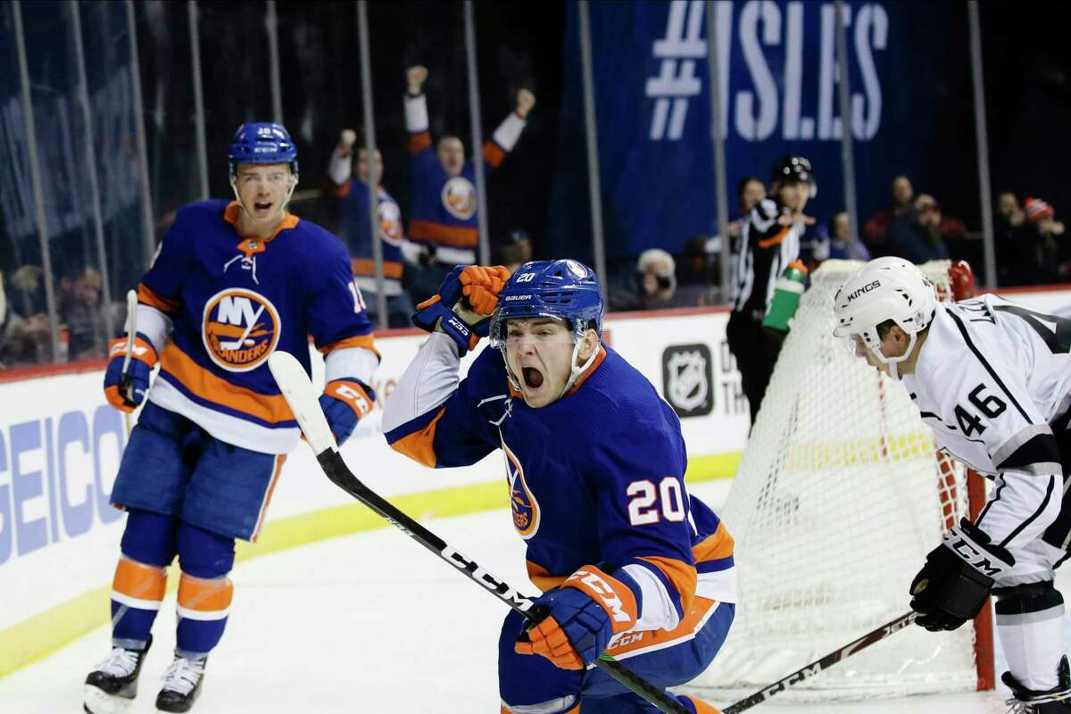 The Islanders' Kieffer Bellows (20) celebrates after scoring his first NHL goal, as teammate Anthony Beauvillier, left, and the Kings' Blake Lizotte, right, reacton Feb. 6 in New York.
