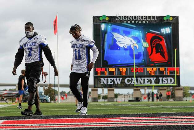 New Caney defensive end Derrick Harris, Jr. (7) and defensive back Cale Sanders, Jr. (11) walk the field before a District 8-5A high school football game at Randall Reed Stadium, Friday, Oct. 9, 2020, in Porter. Both Harirs and Sanders did not play in the game due to injuries. Photo: Jason Fochtman, Staff Photographer / 2020 © Houston Chronicle
