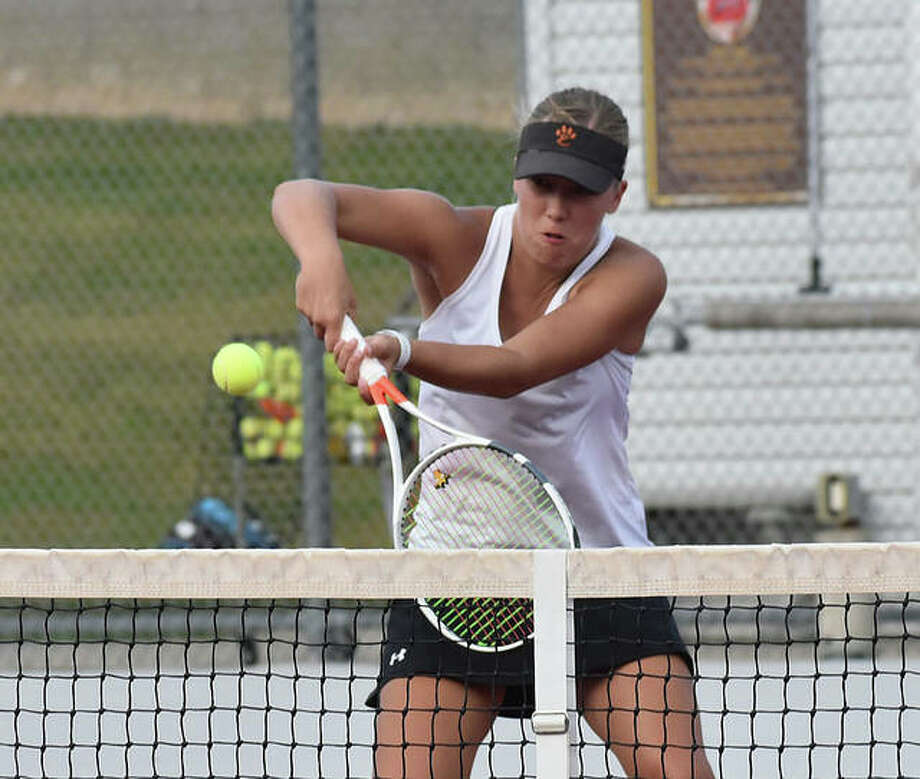 Edwardsville's Hannah Colbert positions herself to hit a backhand shot near the net during her doubles match Friday in the Southwestern Conference Tournament at Alton.