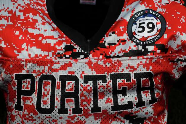 A customer uniform sticker for the Battle Line on 59 rivalry game between Porter and New Caney is seen before a District 8-5A high school football game at Randall Reed Stadium, Friday, Oct. 9, 2020, in Porter. Photo: Jason Fochtman, Staff Photographer / 2020 © Houston Chronicle