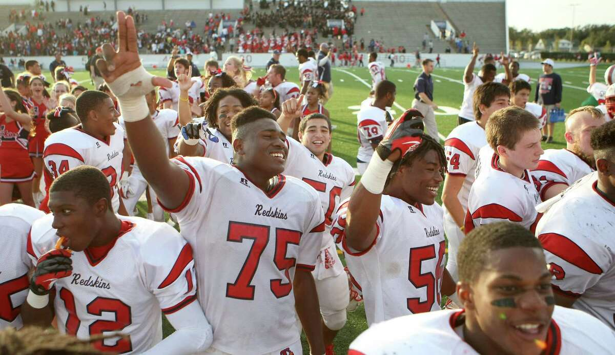Jonathan Beaudion (75) and the Lamar High School footbal team celebrate after beating North Shore High School in a 5A Division Region III final, Saturday, Dec. 8, 2012, in Veterans Memorial Stadium in Pasadena. ( Nick de la Torre / Houston Chronicle )