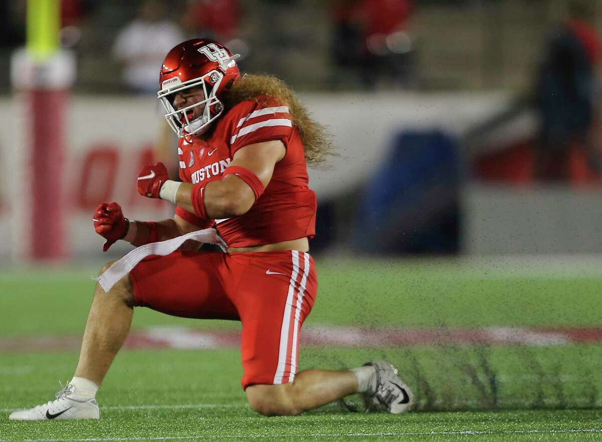 Houston linebacker Grant Stuard, celebrating a sack against Tulane, was named first-team all-conference in the AAC.