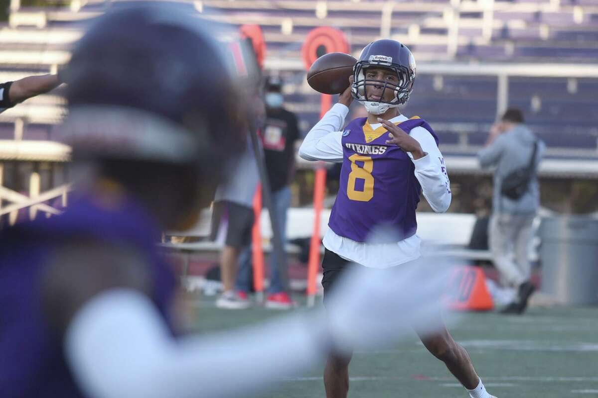 Westhill quarterback Joshua Ortiz (8) throws a pass to a receiver during the Vikings' 7-on-7 football game versus New Canaan at Westhill on Friday, Oct. 9, 2020.