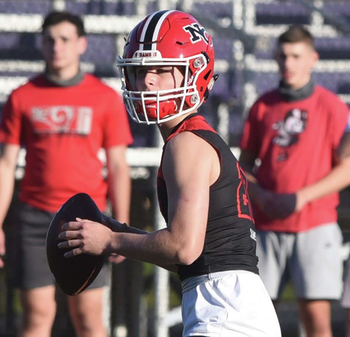 New Canaan quarterback Henry Cunney looks downfield during a 7-on-7 football game at Westhill High School on Friday, Oct. 9, 2020.