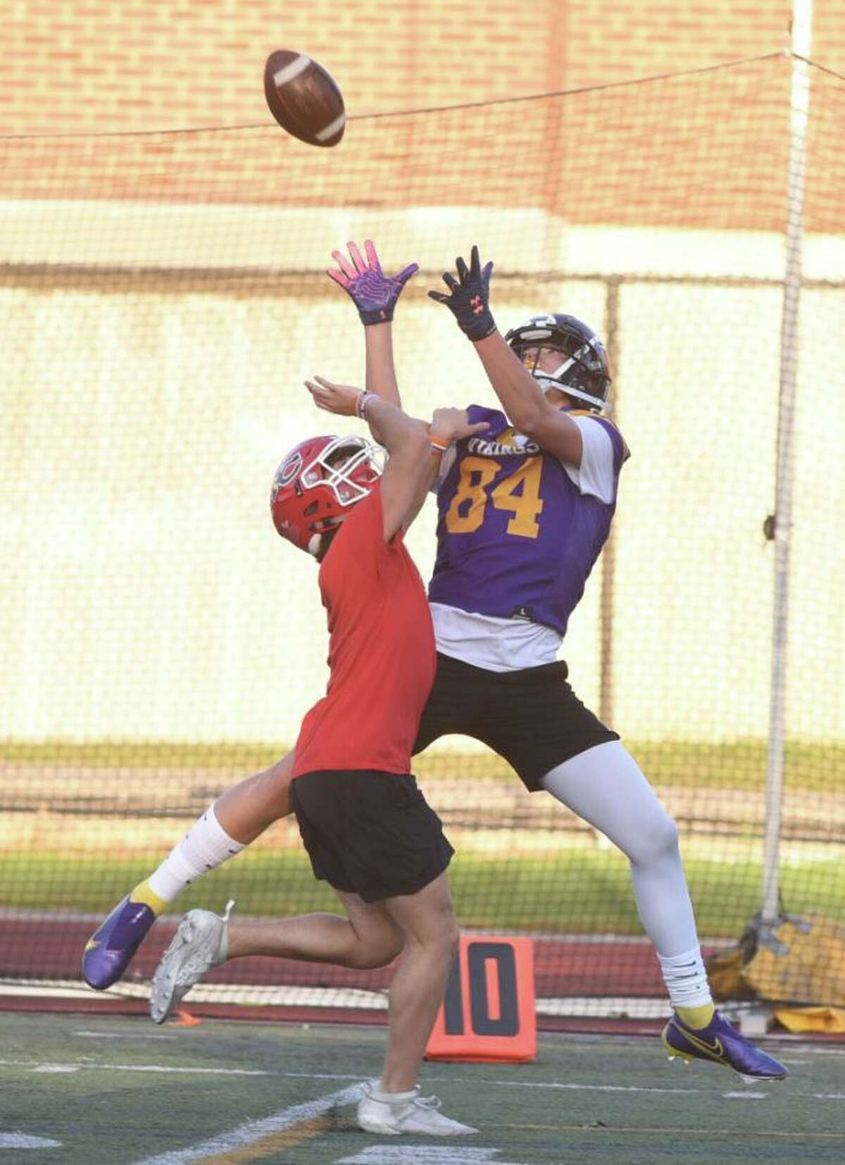 Westhill's Ryder Kurtz (84) goes up to make a reception during the Vikings' 7-on-7 football game versus New Canaan at Westhill on Friday, Oct. 9, 2020.