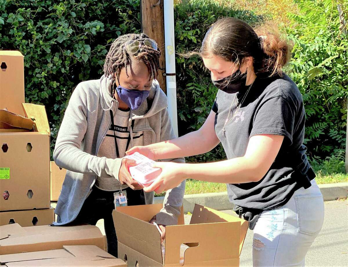Volunteers at Macdonough Elementary School in Middletown distributed 600 boxes in two hours to local families Thursday as part of the Farmers to Families program.