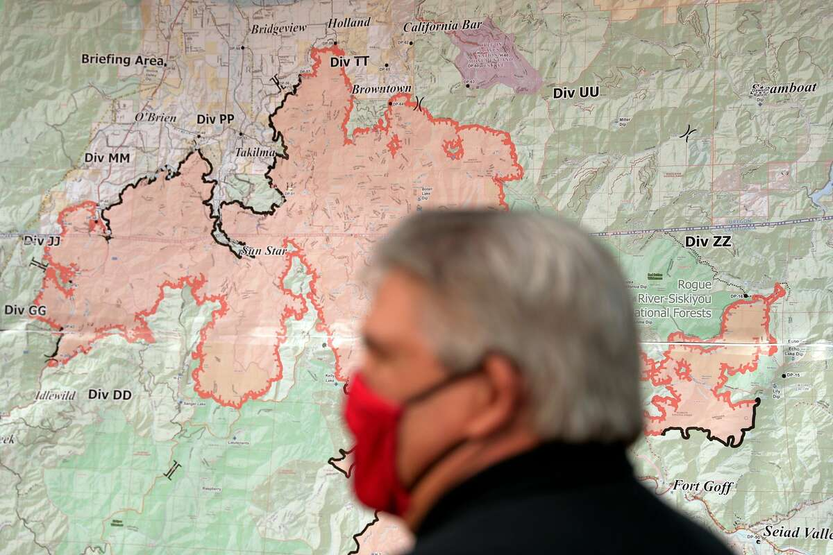Karuk Tribal Chairman Russell Attebery looks over a map of the area burned by the Slater Fire in Happy Camp in Siskiyou County last month.