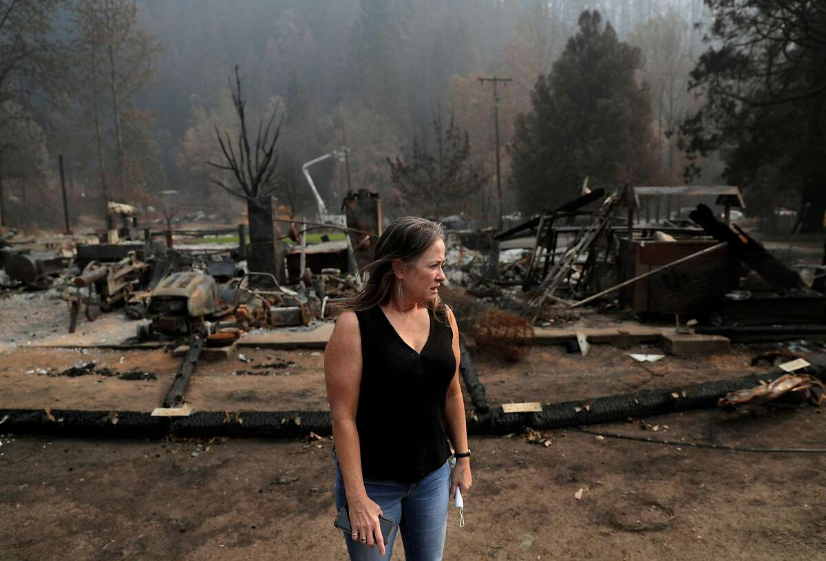 Erin Hillman, a member of the Karuk Tribe, takes in the damage to her home from the Slater Fire. Karuk leaders had for years been urging the U.S. Forest Service to employ traditional prescribed burning techniques in the area, to no avail.
