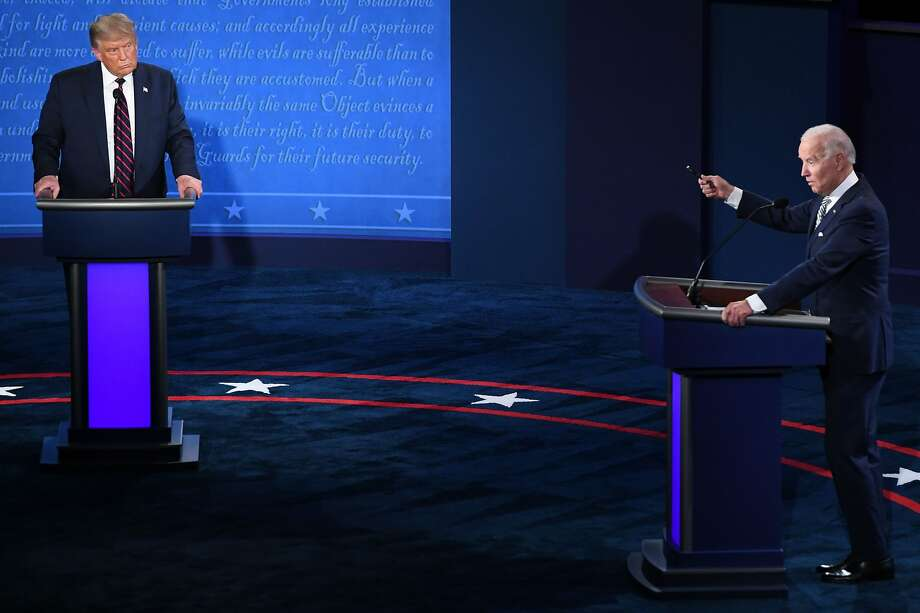 (FILES) In this file photo taken on September 29, 2020 US President Donald Trump and Democratic Presidential candidate and former US Vice President Joe Biden take part in the first presidential debate at Case Western Reserve University and Cleveland Clinic in Cleveland, Ohio. - The presidential debate between Democratic Presidential candidate and former US Vice President Joe Biden and US President Donald Trump scheduled for October 15 has been cancelled by the Commission on Presidential Debates, US media reported on October 9, 2020. (Photo by SAUL LOEB / AFP) (Photo by SAUL LOEB/AFP via Getty Images) Photo: Saul Loeb / AFP / Getty Images 2020