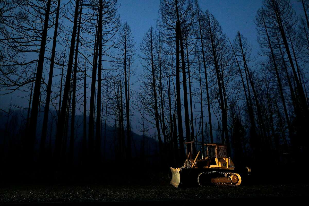 A bulldozer sits amid the ruin left by the Slater Fire in Happy Camp (Siskiyou County). The Kurok Tribe's traditional burns to control fires in the area were blocked by federal officials.