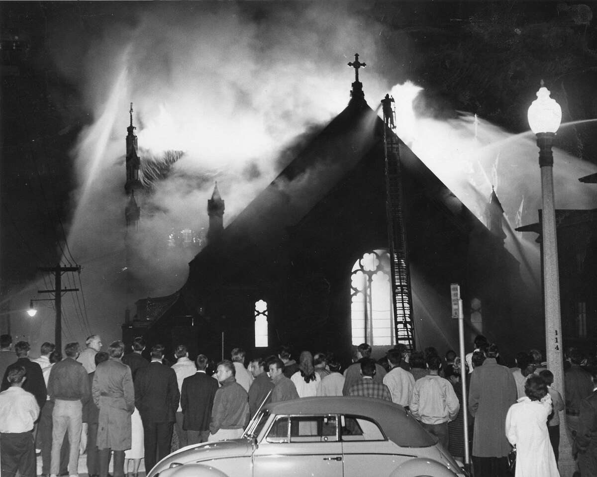 Spectators watch as St Mary's Cathedral is destroyed in a fire, September 8, 1962 United Press International photo