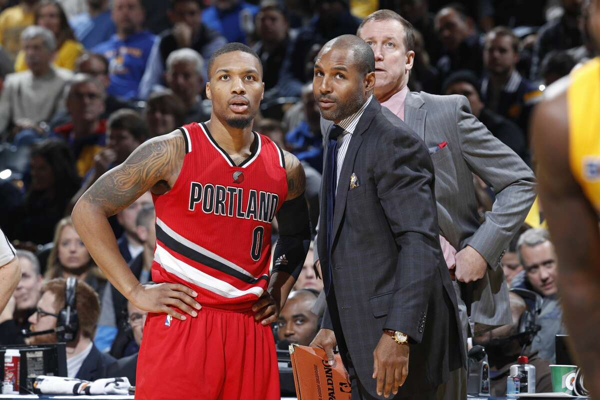 INDIANAPOLIS, IN - DECEMBER 10: Damian Lillard #0 of the Portland Trail Blazers talks to assistant coach David Vanterpool during the game against the Indiana Pacers at Bankers Life Fieldhouse on December 10, 2016 in Indianapolis, Indiana. The Pacers defeated the Trail Blazers 118-111. (Photo by Joe Robbins/Getty Images)