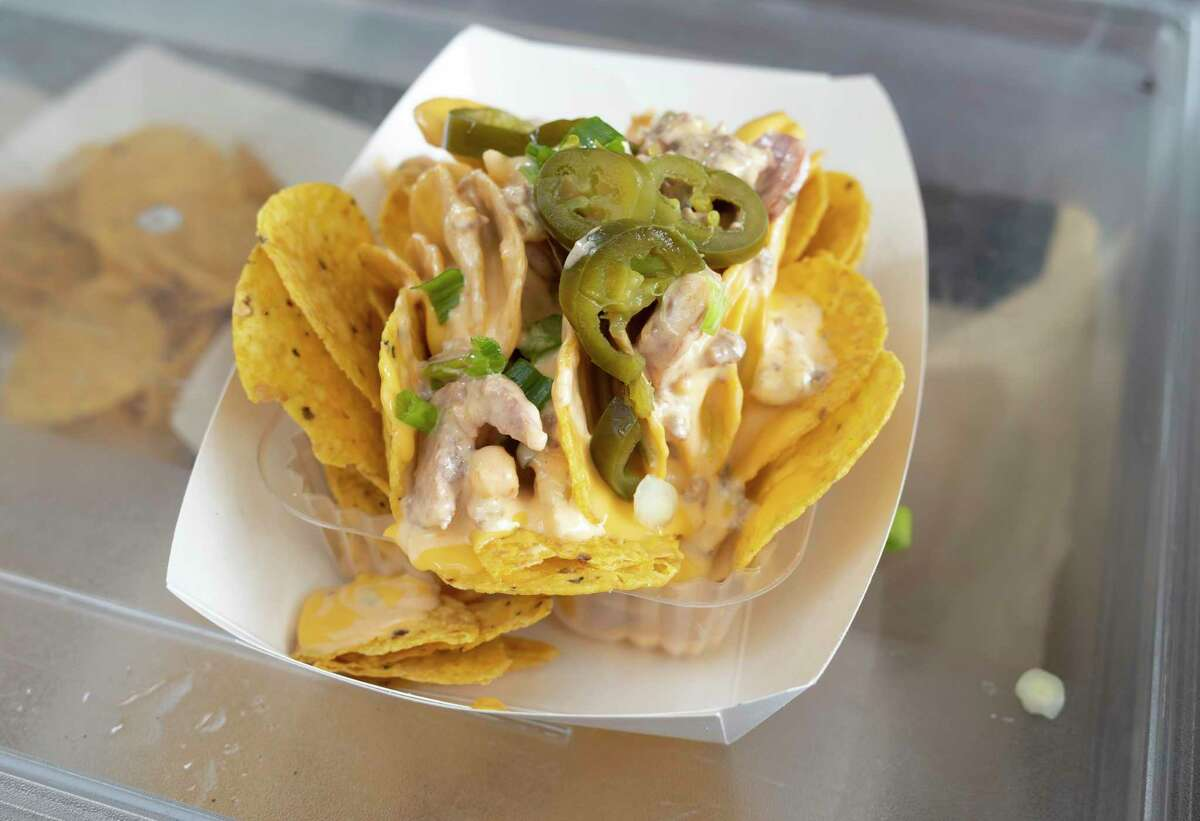 A plate of Cajun nachos is prepared by Mardi Gras's Cajun Cuisine which offers authentic creole style foods at the 2020 Conroe Cajun Catfish Festival, Friday, Oct. 9, 2020. The food truck often competes in the Waco food truck competition.