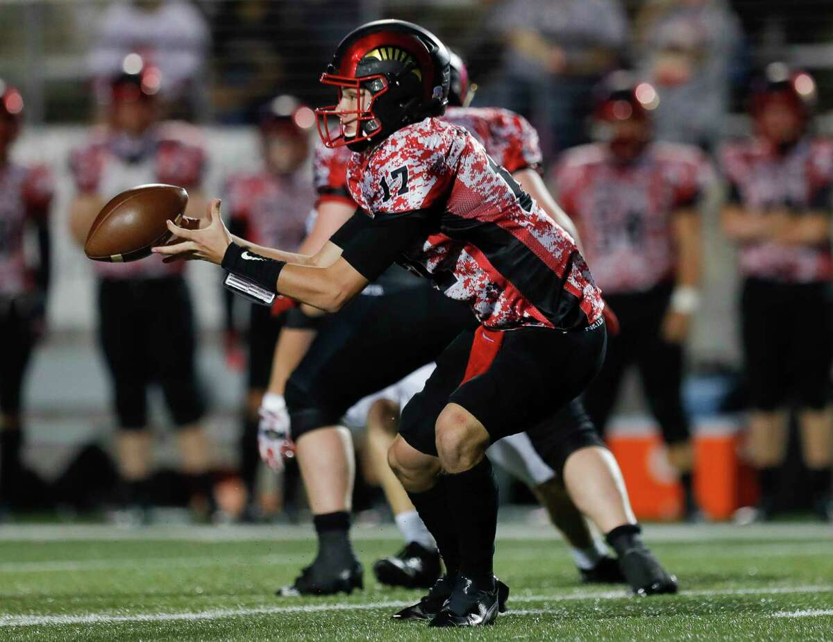 Porter quarterback Jace Russell (17) bobbles the ball during the second quarter of a District 8-5A high school football game at Randall Reed Stadium, Friday, Oct. 9, 2020, in Porter.