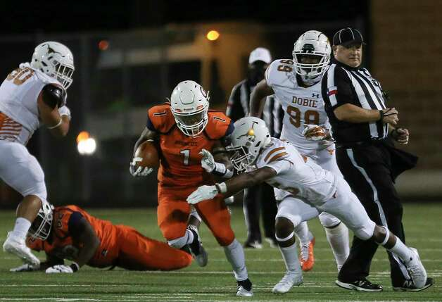Bush Broncos running back Jarbari Kuykendall carries the ball while Dobie Longhorns defensive back Ryan Saxton is tackling during the second quarter of the game Friday, Oct. 9, 2020, at Hall Stadium  in Missouri City. Photo: Yi-Chin Lee, Staff Photographer / © 2020 Houston Chronicle