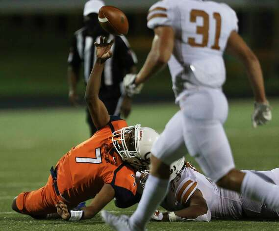 Bush Broncos quarterback Tyler Hilder makes a pass as hs ie brought down during the second quarter of the game against Dobie Longhorns Friday, Oct. 9, 2020, at Hall Stadium  in Missouri City. Photo: Yi-Chin Lee, Staff Photographer / © 2020 Houston Chronicle
