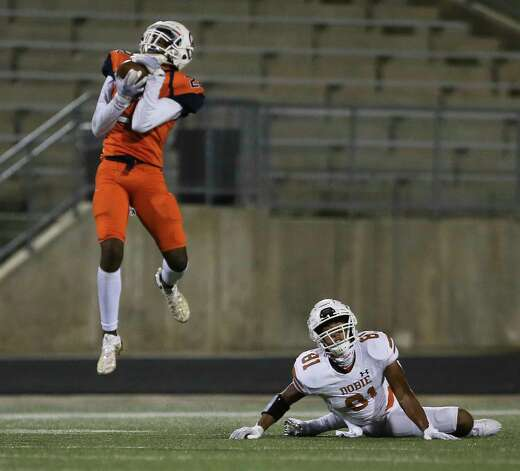 Dobie Longhorns wide receiver Jeremiah Ballard (81) watches Bush Broncos defensive back Paul Omodia (22) intercepts an intended pass for him during the first quarter of the game Friday, Oct. 9, 2020, at Hall Stadium in Missouri City. Photo: Yi-Chin Lee, Staff Photographer / © 2020 Houston Chronicle