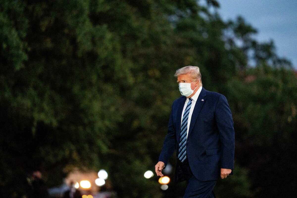 President Donald Trump is shown returning to the White House from Walter Reed National Military Medical Center, where he was treated after testing positive for the coronavirus, Oct. 5, 2020. Republicans in battleground states or districts are keeping their distance from Trump. Some won't even mention his name.
