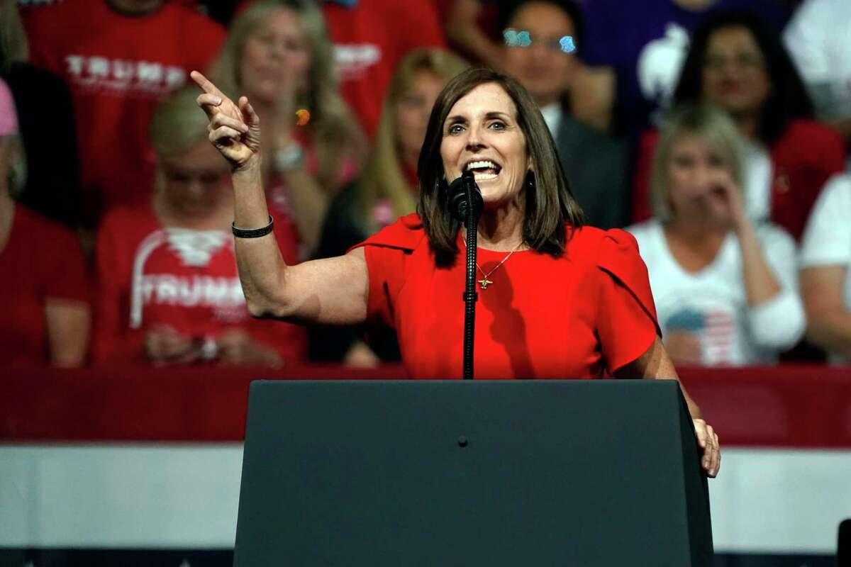 """In this Feb. 19, 2020, Sen. Martha McSally, R-Ariz., speaks at a rally for President Donald Trump in Phoenix. At the event, McSally said, """"I'm flying on your wing, President Trump."""" At a debate last week, she sidestepped questions about her support of Trump."""