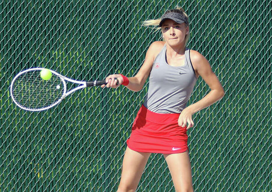 Alton's Ainsley Fortschneider, above, and doubles teammate Paige Rockholm finished sixth in the No. 1 doubles flight at Friday's Southwestern conference Tournament at Alton High. Singles play is set for Saturday at AHS, Gordon Moore Park and Roxana High School. Photo: Greg Shashack | The Telegraph