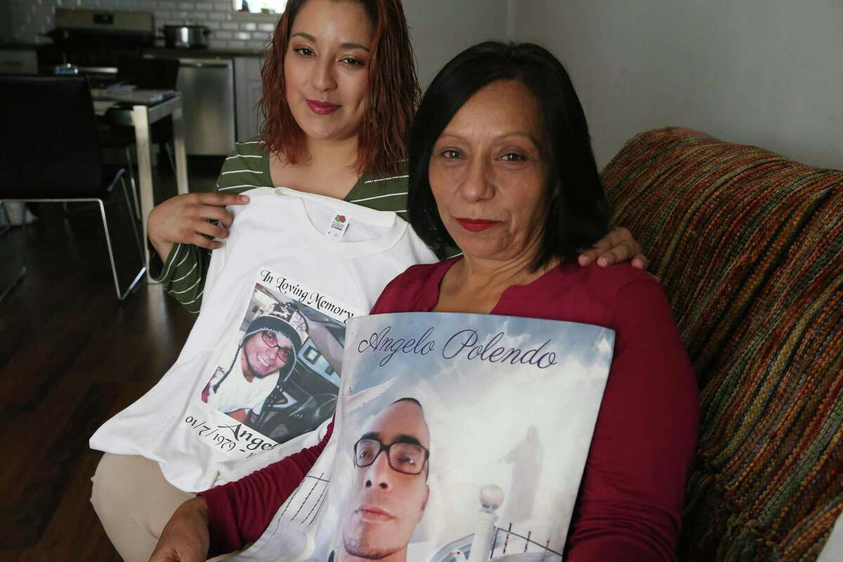 Eliza Polendo, 59, and her daughter, Amanda, 31, hold a tee shirt with an image of her son, Angelo Polendo, 37, at her home, Friday, Oct. 9, 2020. Her son was shot dead in October of 2016 and the case remains unsolved. Crime Stoppers has renewed the reward of up to $5,000.