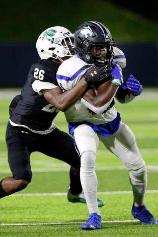 Dekaney's Jaiden Robertson (5) is caught by Spring defensive back Jeffery Foster (26) during the first half of a high school football game Friday, Oct. 9, 2020 at Planet Ford Stadium in Spring, TX. Photo: Michael Wyke, Contributor / © 2020 Houston Chronicle