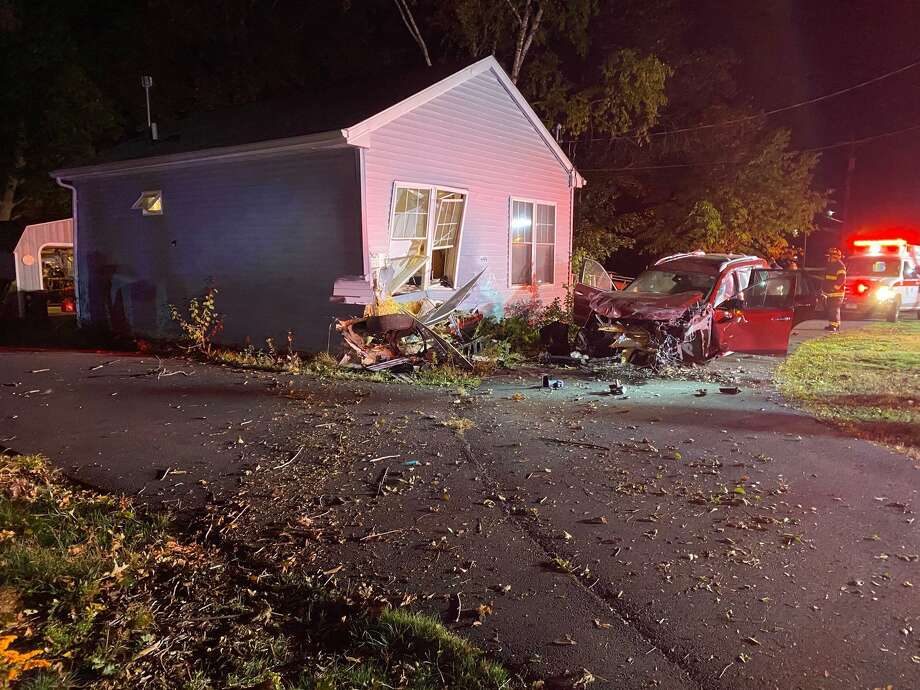 "Community services are helping the residents of a Meriden Avenue home in Southington, Conn. after it was struck by a car, leaving the home ""uninhabitable,"" police said. Photo: Contributed /Southington Police Department"