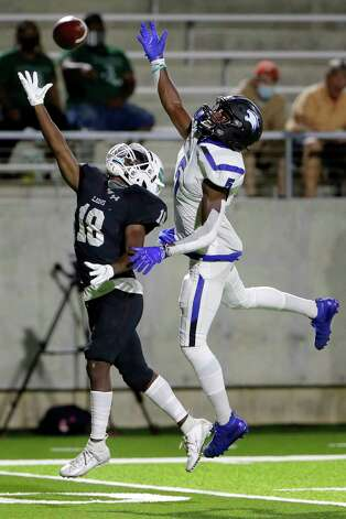 Spring wide receiver Isaiah Johnson (18) can't make the reception under pressure from Dekaney defender Jaiden Robertson (5) during the first half of a high school football game Friday, Oct. 9, 2020 at Planet Ford Stadium in Spring, TX. Photo: Michael Wyke, Contributor / © 2020 Houston Chronicle