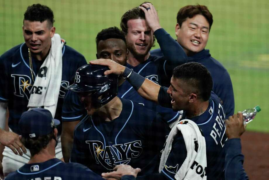 Tampa Bay Rays' Michael Brosseau celebrates with teammates after hitting a solo home run during the eighth inning in Game 5 of a baseball American League Division Series against the New York Yankees, Friday, Oct. 9, 2020, in San Diego. (AP Photo/Jae C. Hong) Photo: Jae C. Hong, Associated Press / Copyright 2020 The Associated Press. All rights reserved