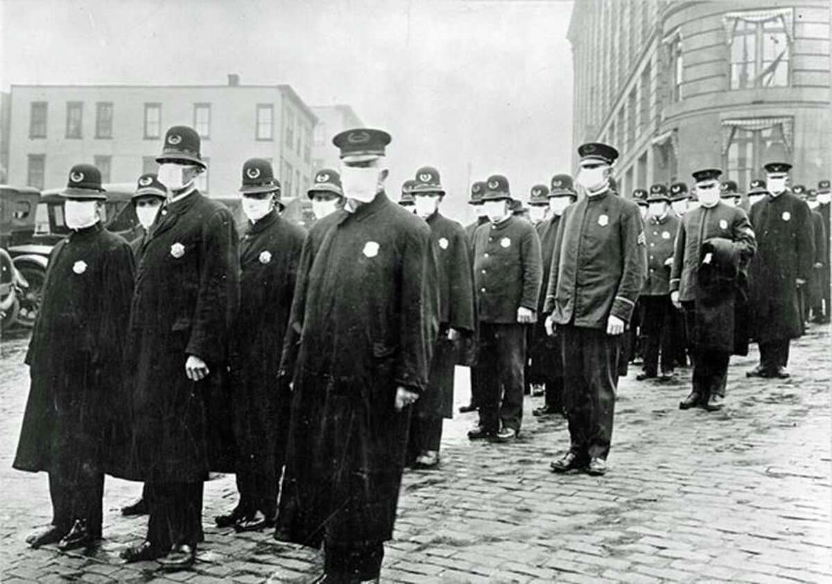 Police in Seattle wearing masks provided by the Red Cross during the influenza epidemic in 1918.