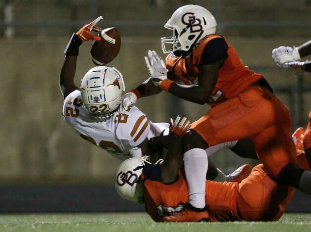 Dobie Longhorns defensive back Paul Omodia scores a touchdown while Bush Broncos players are trying to stop him during the fourth quarter of the game Friday, Oct. 9, 2020, at Hall Stadium in Missouri City. The Longhorns defeated the Broncos 62-12. Photo: Yi-Chin Lee, Staff Photographer / © 2020 Houston Chronicle
