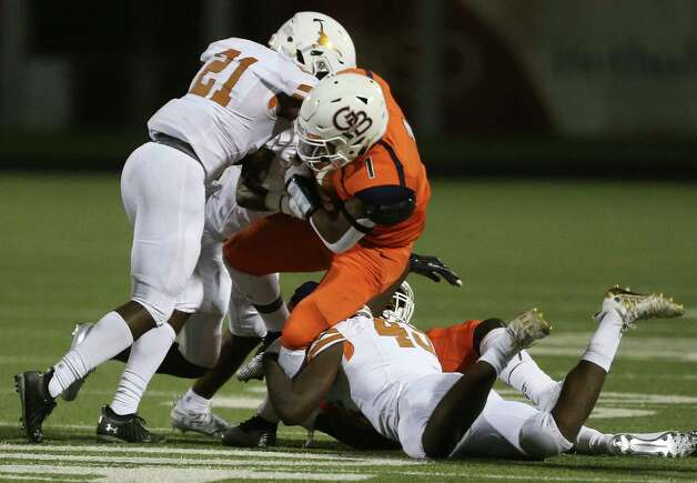 Bush Broncos running back Jarbari Kuykendall is tackled by Dobie Longhorns players during the third quarter of the game Friday, Oct. 9, 2020, at Hall Stadium in Missouri City. Photo: Yi-Chin Lee, Staff Photographer / © 2020 Houston Chronicle