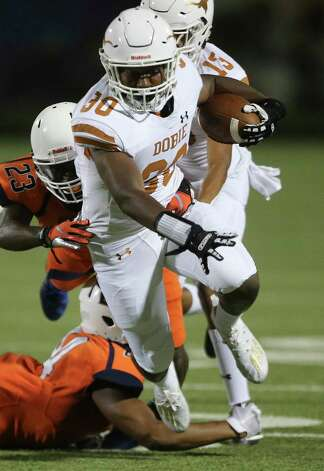 Dobie Longhorns running back Terrand Booker runs the ball while Bush Broncos players are trying to stop him during the third quarter of the game Friday, Oct. 9, 2020, at Hall Stadium in Missouri City. Photo: Yi-Chin Lee, Staff Photographer / © 2020 Houston Chronicle