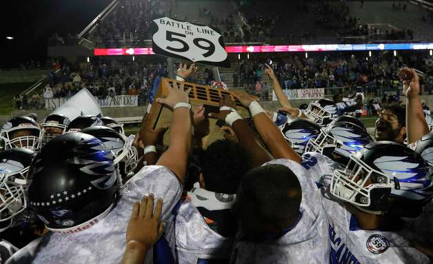 New Caney players celebrate after defeating rival Porter 21-19 during a District 8-5A high school football game at Randall Reed Stadium, Friday, Oct. 9, 2020, in Porter. Photo: Jason Fochtman, Staff Photographer / 2020 © Houston Chronicle