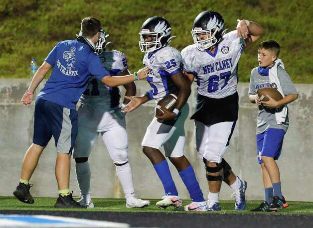 New Caney running back Kedrick Reescano (25) reacts after running of a 4-yard touchdown during the fourth quarter of a District 8-5A high school football game at Randall Reed Stadium, Friday, Oct. 9, 2020, in Porter. Photo: Jason Fochtman, Staff Photographer / 2020 © Houston Chronicle