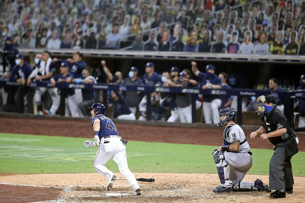 Tampa Bay's Michael Brosseau hits a solo home run in the eighth inning, a series-winning hit.