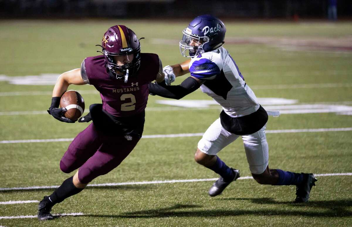 Magnolia West wide receiver Trey Leggett (2) gets corralled off the field by Lufkin wide receiver Cristian Diaz (4) during the fourth quarter of a District 8-5A (Div. I) play at Mustang Stadium in Magnolia, Friday, Oct. 9, 2020.