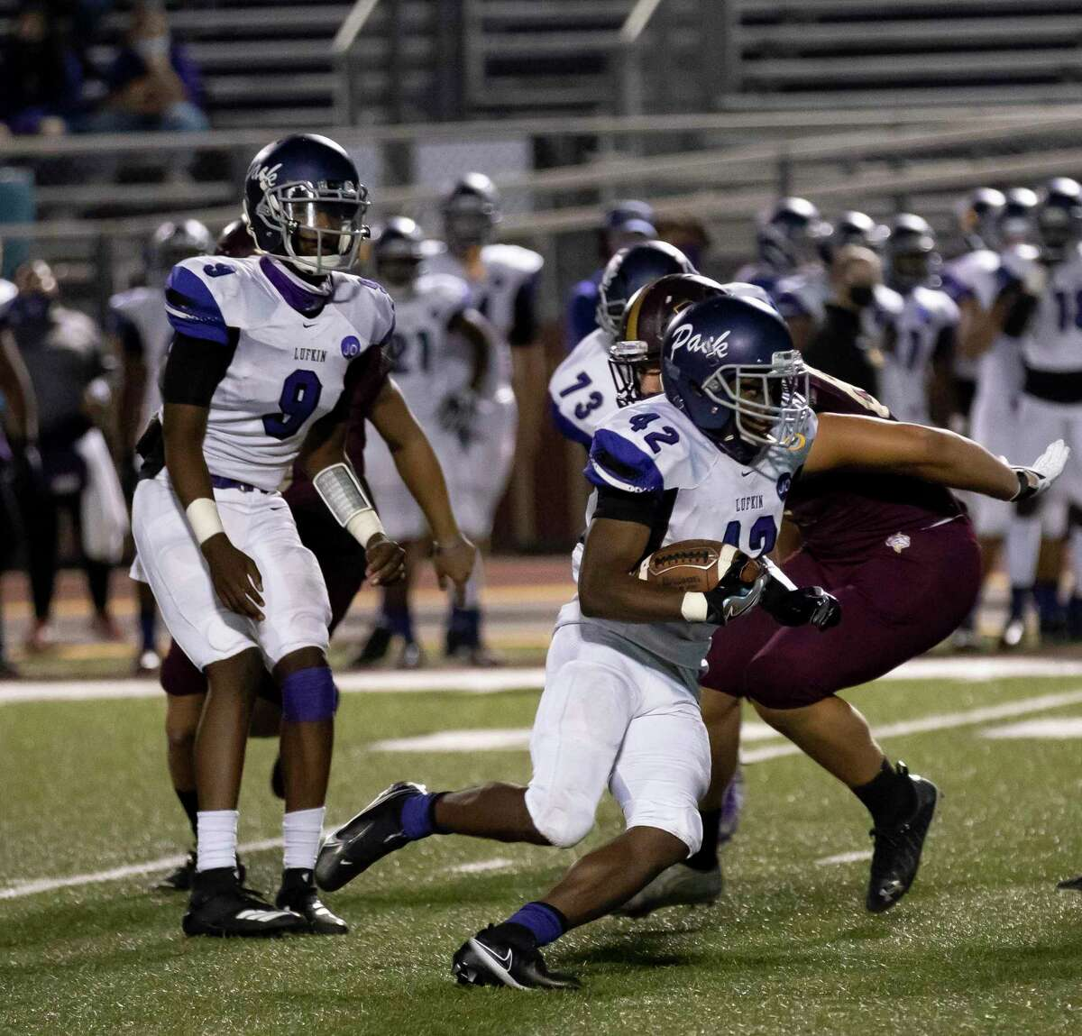Lufkin running back Justavian Fann (42) runs the ball down the field before being tackled by Magnolia West defensive line Hayden Jansky (89) during the third quarter of a District 8-5A (Div. I) play at Mustang Stadium in Magnolia, Friday, Oct. 9, 2020.
