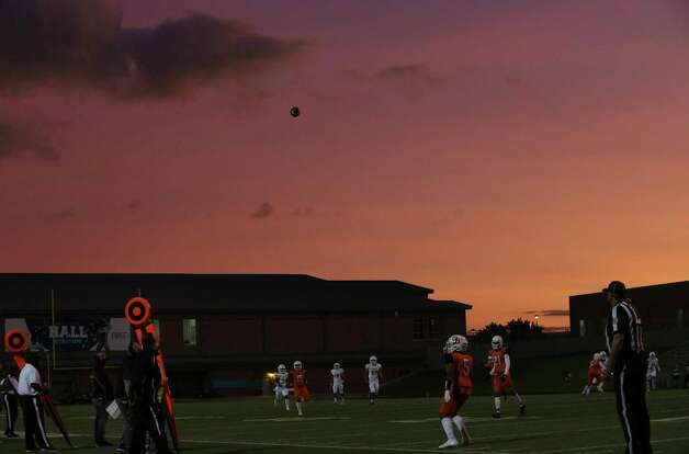 The sun sets during the first quarter of the game between Bush Broncos and Dobie Longhorns Friday, Oct. 9, 2020, at Hall Stadium in Missouri City. Photo: Yi-Chin Lee, Staff Photographer / © 2020 Houston Chronicle