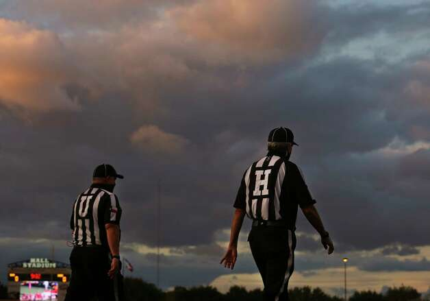 Referees walk onto the field before kick off between Bush Broncos and Dobie Longhorns Friday, Oct. 9, 2020, at Hall Stadium  in Missouri City. Photo: Yi-Chin Lee, Staff Photographer / © 2020 Houston Chronicle