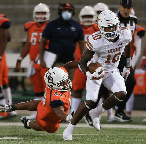 Dobie Longhorns Johnathan Baldwin runs the ball while Bush Broncos Brandon Chambers tackles during the first quarter of the game Friday, Oct. 9, 2020, at Hall Stadium  in Missouri City. Photo: Yi-Chin Lee, Staff Photographer / © 2020 Houston Chronicle