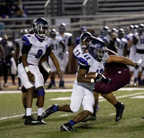 Lufkin running back Justavian Fann (42) runs the ball down the field before being tackled by Magnolia West defensive line Hayden Jansky (89) during the third quarter of a District 8-5A (Div. I) play at Mustang Stadium in Magnolia, Friday, Oct. 9, 2020. Photo: Gustavo Huerta, Staff Photographer / 2020 © Houston Chronicle