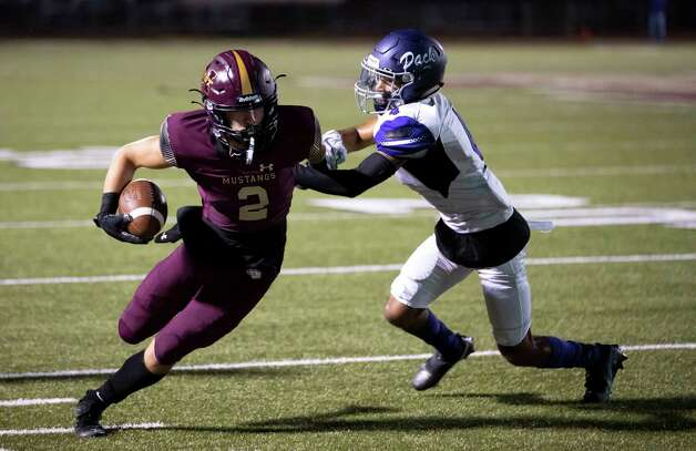 Magnolia West wide receiver Trey Leggett (2) gets corralled off the field by Lufkin wide receiver Cristian Diaz (4) during the fourth quarter of a District 8-5A (Div. I) play at Mustang Stadium in Magnolia, Friday, Oct. 9, 2020. Photo: Gustavo Huerta, Staff Photographer / 2020 © Houston Chronicle