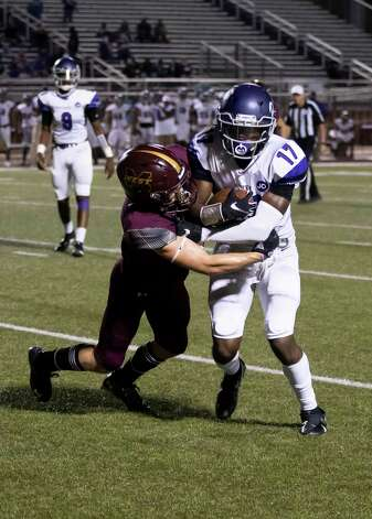 Magnolia West defensive back Tye Copeland (1) grabs onto Lufkin wide receiver Journie Thomas (17) during the fourth quarter of a District 8-5A (Div. I) play at Mustang Stadium in Magnolia, Friday, Oct. 9, 2020. Photo: Gustavo Huerta, Staff Photographer / 2020 © Houston Chronicle